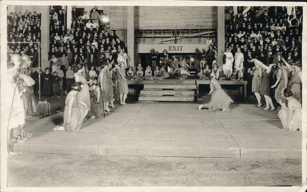 Multiple students performing skits in the Red Gym for the UW Circus ca. 1921.