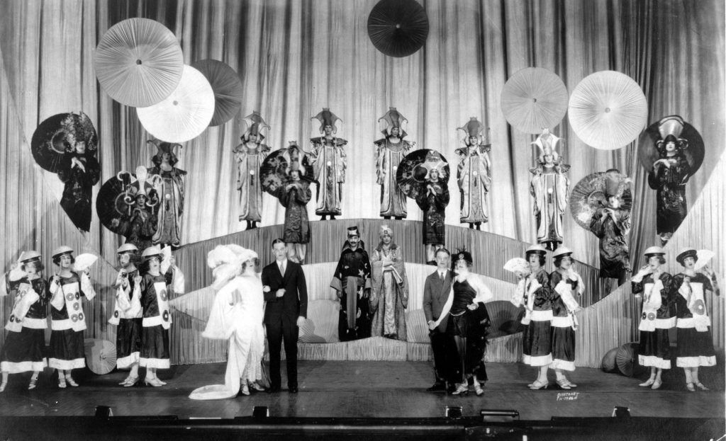 Large group photo of Haresfoot Club members dressed for Twinkle Twinkle performance ca. 1924.