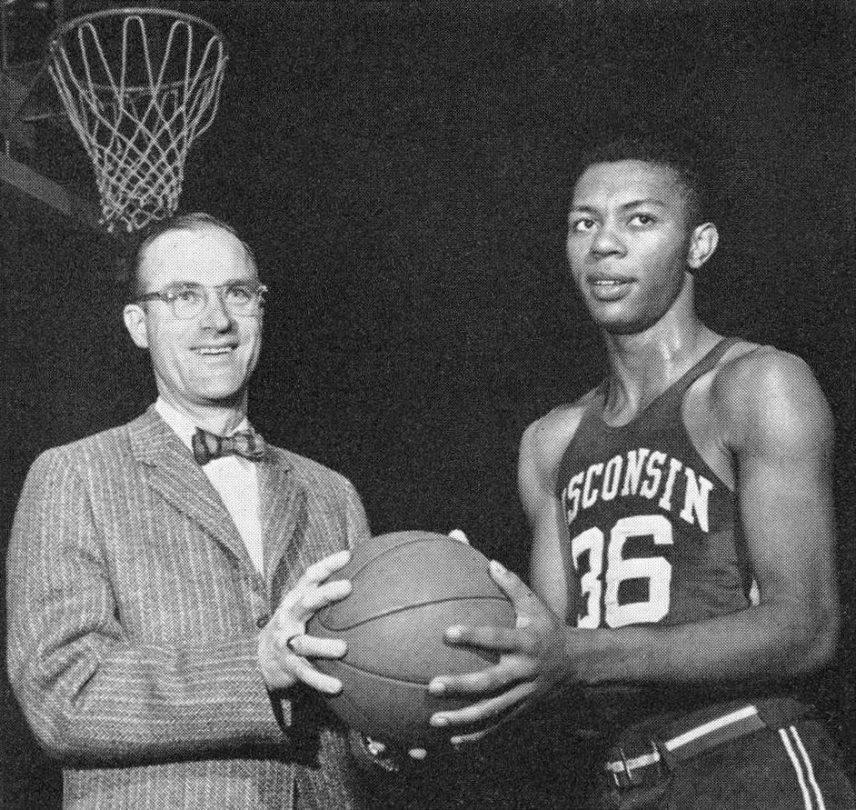Ivan Jefferson poses holding a basketball with Coach Al Hovland.