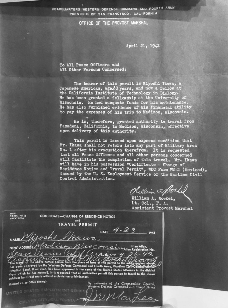 Photograph of a letter and permit from 1942, allowing a Japanese American student to travel to UW–Madison. Full text is above.