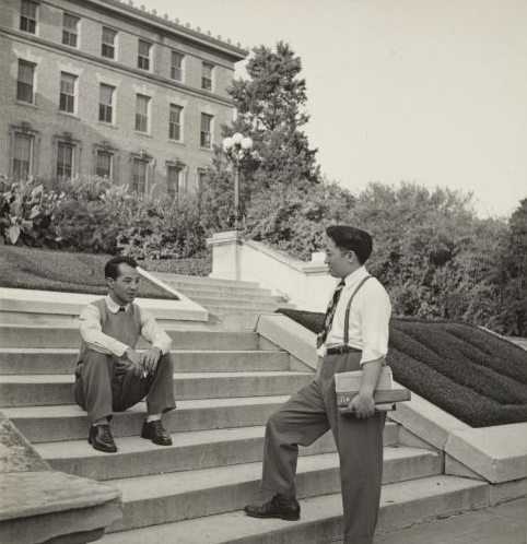 Keith Nakamura and Toru Iura, both undergraduate students at UW, are shown at the entrance to the College of Agriculture building.