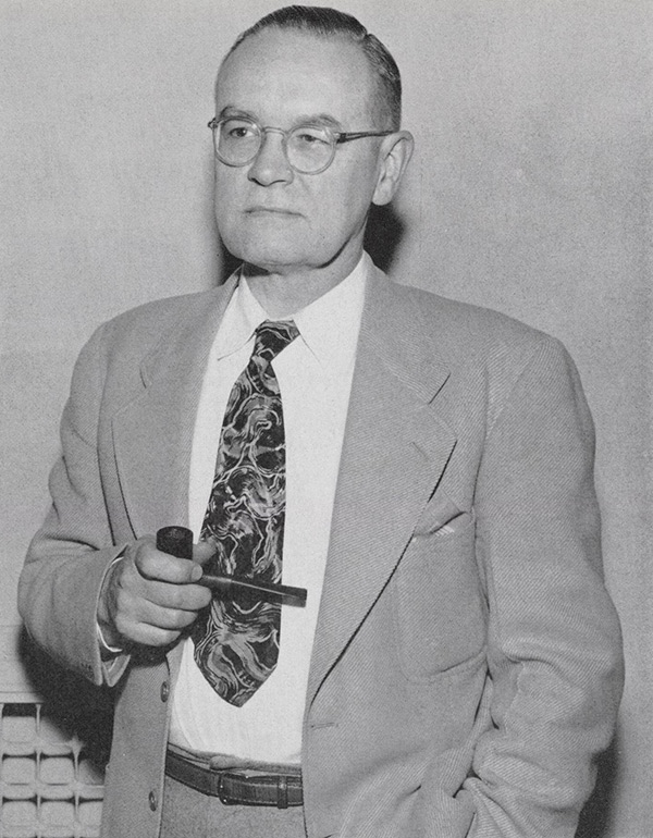 Black and white photo of Theodore Zillman, holding a pipe.